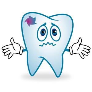 Зуб с кариесом